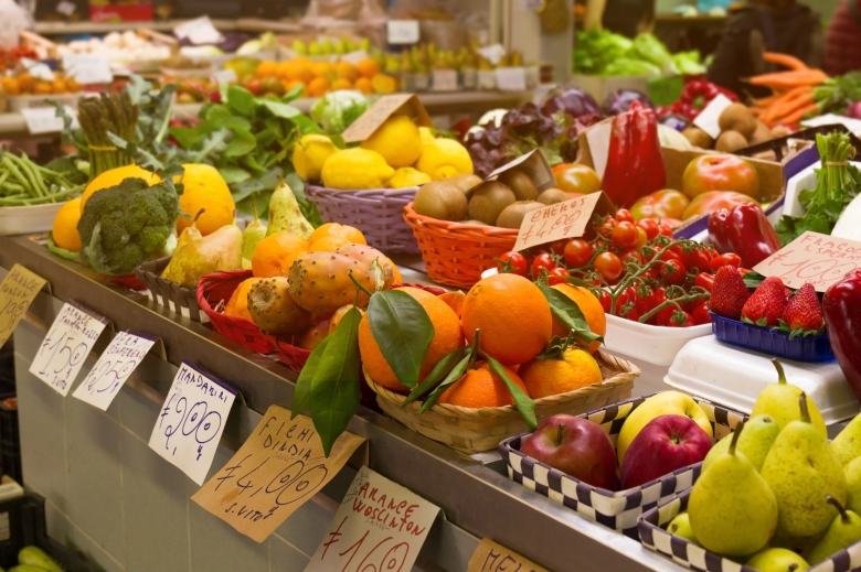 Variety of tasty natural fruits and vegetables in italian market
